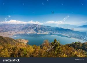 stock-photo-aerial-view-to-phewa-lake-and-annapurna-range-from-world-peace-pagoda-in-pokhara-nepal-267671759